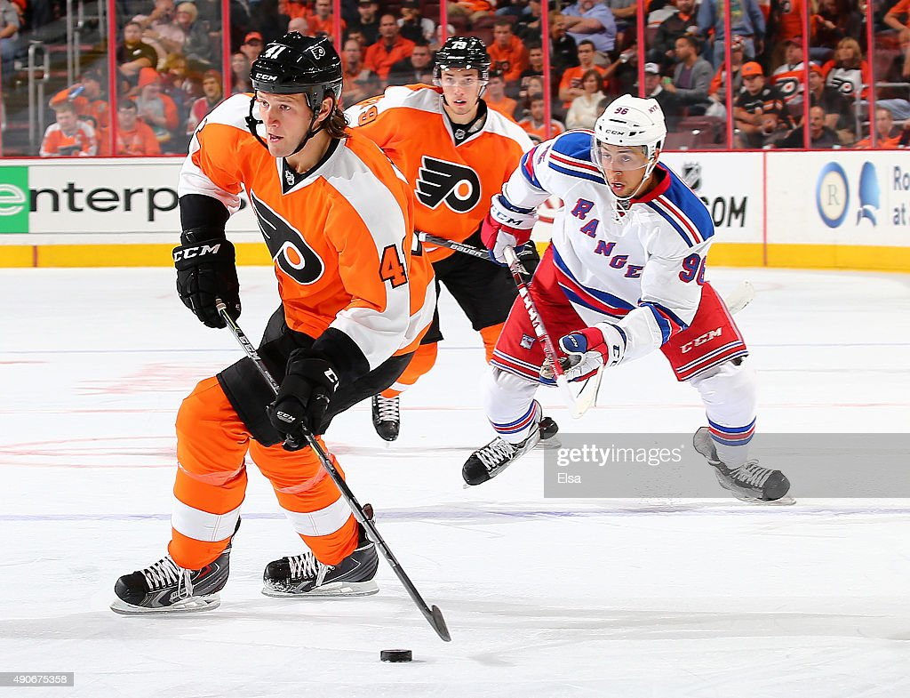 Jay Rosehill of the Philadelphia Flyers takes the puck as Emerson Etem of the New York Rangers defends on April 7 2015 at the Wells Fargo Center in...