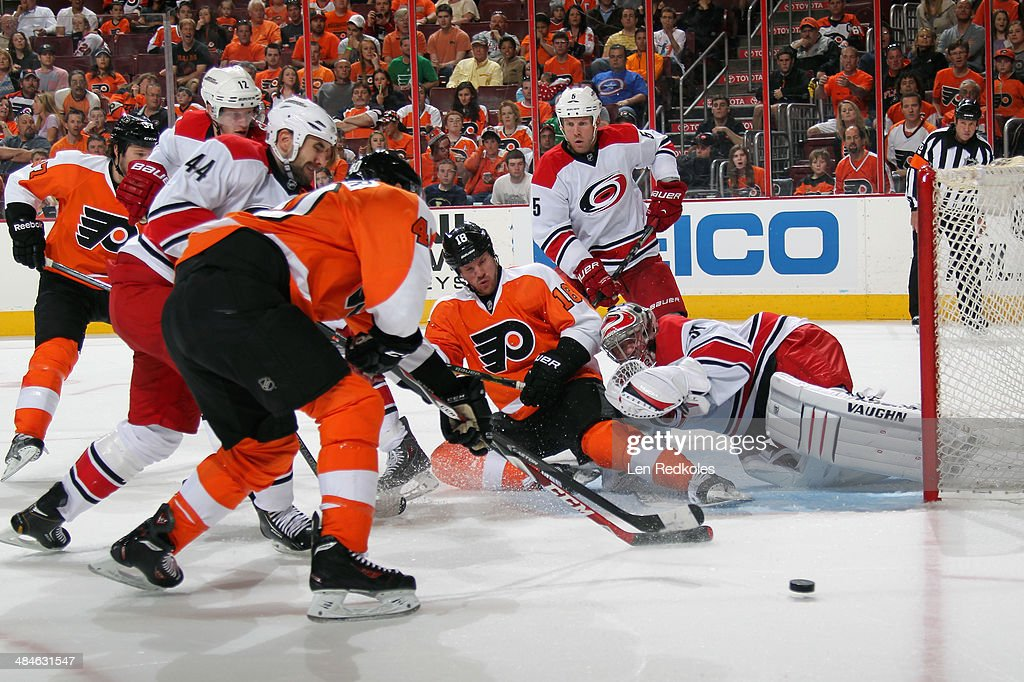 Jay Rosehill Vincent Lecavalier and Adam Hall of the Philadelphia Flyers battle for the loose puck in front of goaltender Anton Khudobin of the...