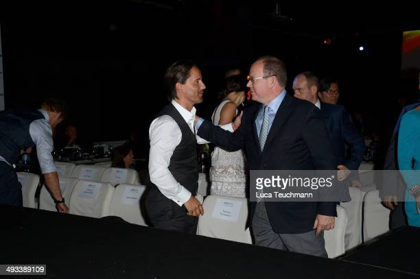 Jay Rutland and Albert II Prince of Monaco attend the Amber Lounge 2014 Gala at Le Meridien Beach Plaza Hotel on May 23 2014 in MonteCarlo Monaco