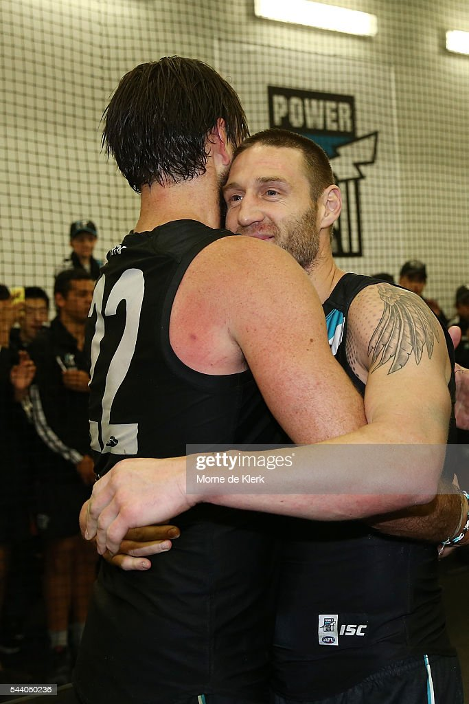 Jay Schulz of the Power celebrates with teammate Charlie Dixon after the round 15 AFL match between the Port Adelaide Power and the Richmond Tigers at Adelaide Oval on July 1, 2016 in Adelaide, Australia.
