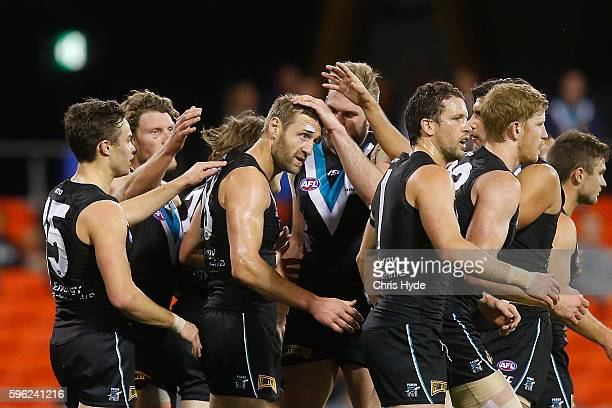 Jay Shultz of the Power celebrates a goal with team mates during the round 23 AFL match between the Gold Coast Suns and the Port Adelaide Power at...
