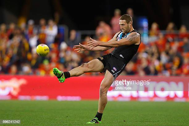 Jay Shultz of the Power kicks during the round 23 AFL match between the Gold Coast Suns and the Port Adelaide Power at Metricon Stadium on August 27...