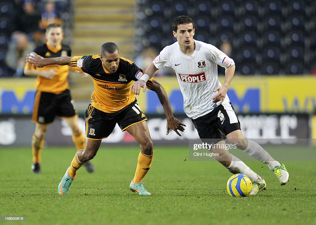 Jay Simpson of Hull City (left) and Mathieu Baudry of Leyton Orient battle for the ball during the FA Cup with Budweiser Third Round match between Hull City and Leyton Orient at the KC Stadium on January 5, 2013 in Hull, England