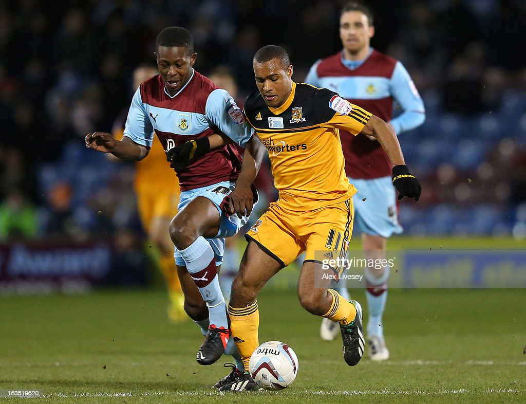 Jay Simpson of Hull City holds off a challenge from Marvin Bartley of Burnley during the npower Championship match between Burnley and Hull City at Turf Moor on March 11, 2013 in Burnley, England.