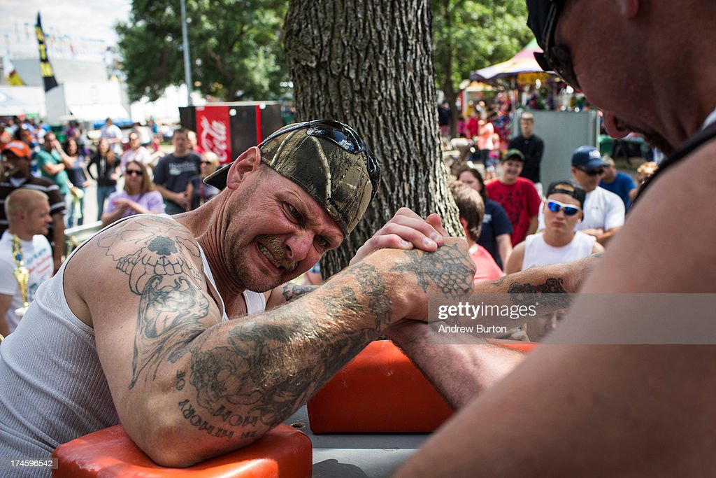 Jay Smith participates in an arm wrestling tournament at the North Dakota state fair on July 27, 2013 in Williston, North Dakota. The western region of North Dakota has seen a rise in crime, automobile accidents and drug usage recently, due in part to the oil boom which has brought tens of thousands of jobs to the region, lowering state unemployment and bringing a surplus to the state budget.