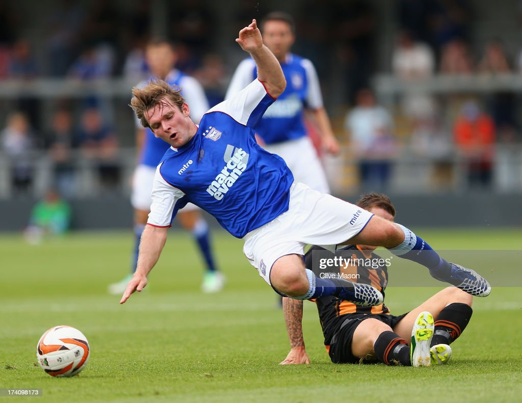 <a gi-track='captionPersonalityLinkClicked' href=/galleries/search?phrase=Jay+Tabb&family=editorial&specificpeople=638761 ng-click='$event.stopPropagation()'>Jay Tabb</a> of Ipswich is tackled during the pre season friendly match between Barnet and Ipswich Town at The Hive on July 20, 2013 in Barnet, England.