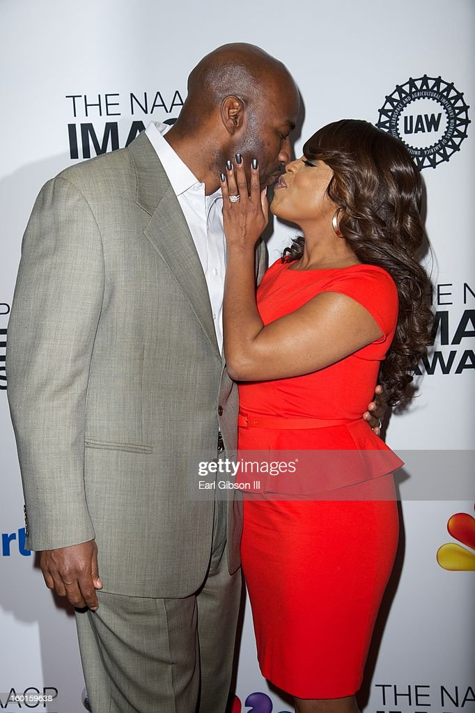 Jay Tucker and wife <a gi-track='captionPersonalityLinkClicked' href=/galleries/search?phrase=Niecy+Nash&family=editorial&specificpeople=228464 ng-click='$event.stopPropagation()'>Niecy Nash</a> share a kiss at the NAACP Image Awards Nominee's Luncheon at Montage Beverly Hills on January 26, 2013 in Beverly Hills, California.