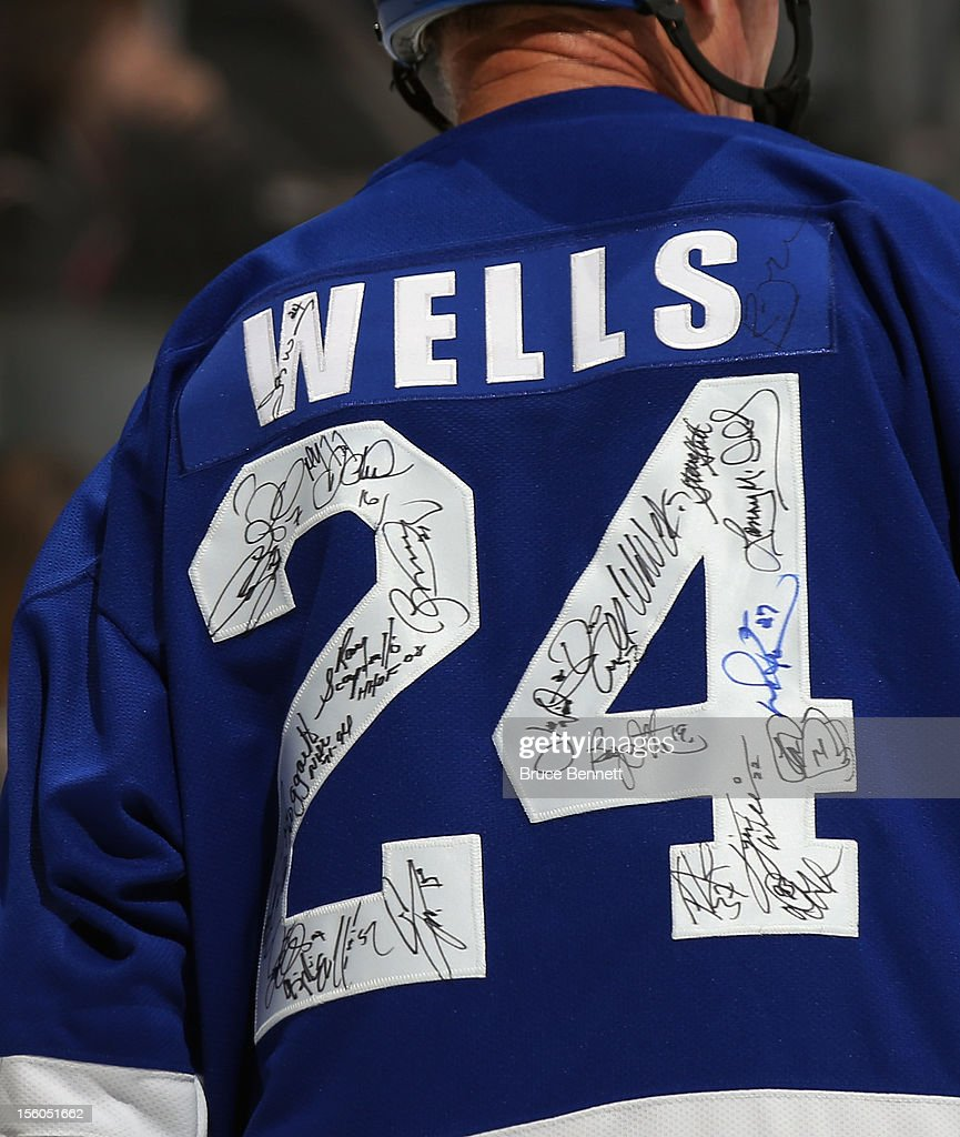 Jay Wells #24 skates in the Hockey Hall of Fame Legends Game as his jersey displays the signatures of other participants at the Air Canada Centre on November 11, 2012 in Toronto, Canada.