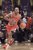 Jay Williams of the Chicago Bulls dribbles up court during The Got Milk Rookie Challenge during the 2003 NBA AllStar weekend at the Philips Arena on...