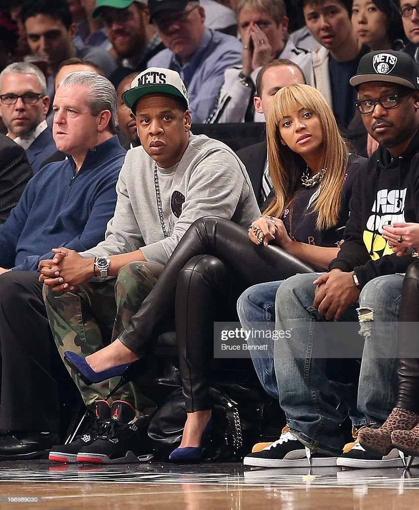 Jay Z and Beyonce attend the game between the Brooklyn Nets and the New York Knicks at the Barclays Center on November 26, 2012 in the Brooklyn borough of New York City.