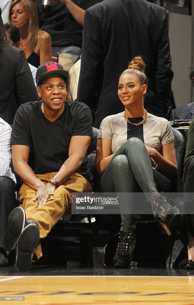 Jay Z and Beyonce Knowles watch the game between the Atlanta Hawks and the Miami Heat on December 10, 2012 at American Airlines Arena in Miami, Florida.