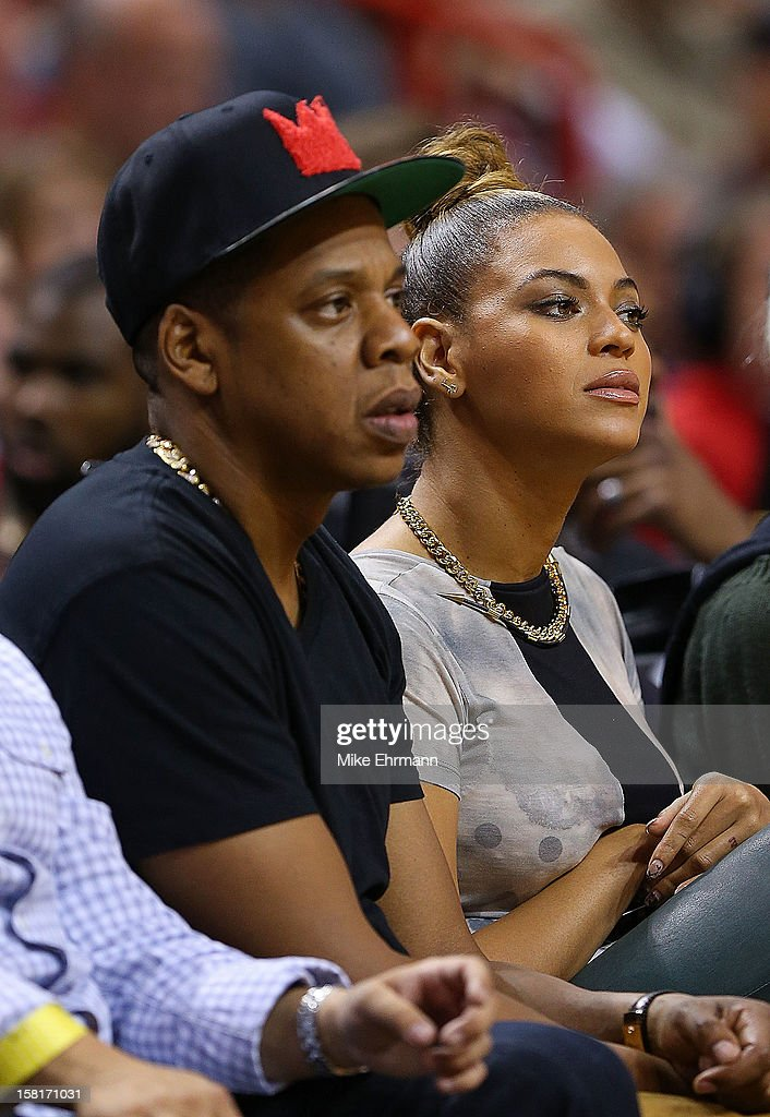 Jay Z and Beyonce Knowles watches a game between the Miami Heat and the Atlanta Hawks at American Airlines Arena on December 10, 2012 in Miami, Florida.