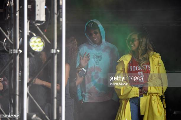 Jay Z and Beyonce watch a performance from the stage during the 2017 Budweiser Made in America festival Day 2 at Benjamin Franklin Parkway on...