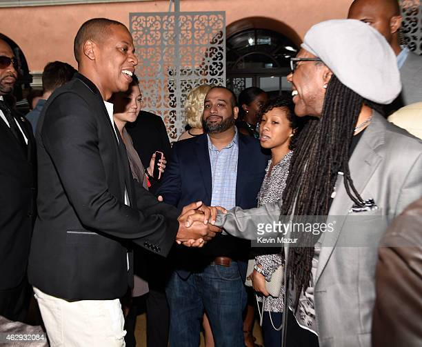 Jay Z and Nile Rodgers attend the Roc Nation and Three Six Zero PreGRAMMY Brunch at Private Residence on February 7 2015 in Beverly Hills California