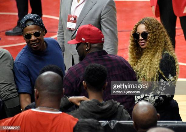 Jay Z greets songwriter/record producer Kenny 'Babyface' Edmonds and his son Dylan Michael Edmonds with Beyonce looking on after attending Game Seven...
