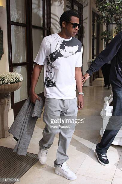 Jay Z leave their hotel to celebrate their wedding anniversary on a romantic dinner at 'L'Avenue' restaurant on April 20 2011 in Paris France