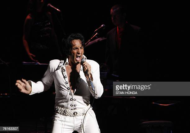 Jay Zanier of Collingwood Ontario Canada performs on stage in The Ultimate Elvis Tribute Artist Contest 17 August 2007 in Memphis Tennessee Fans from...