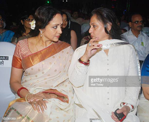Jaya Bachchan chats up Hema Malini on at the launch of 'Chehere' a coffee table book compiled by celebrity photographer Gautam Rajadhakshya in Mumbai...