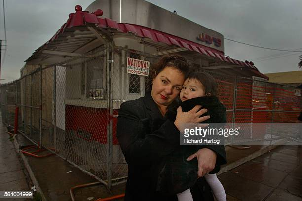 JayAnn Rodgers–Rojas the owner of the legendary Jay's Jayburger stand with her 15–month–old daughter Jolie Rojas Thursday afternoon in Hollywood She...