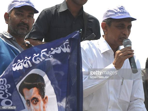 Jayaprakash Narayan founder and the President of Lok Satta Party addresses supporters as film director SS Rajamouli looks on before submitting his...