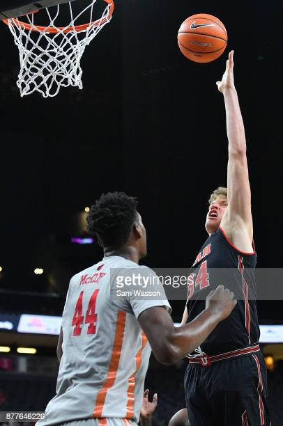 Jayce Johnson of the Utah Utes shoots against Brandon McCoy of the UNLV Rebels during the championship game of the Main Event basketball tournament...
