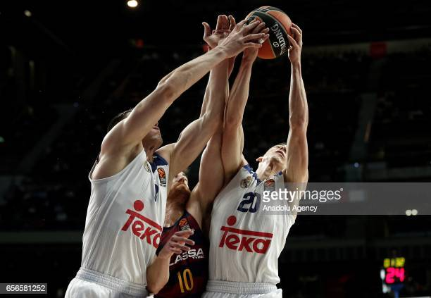 Jaycee Carroll and Jonas Maciulis of Real Madrid in action against Victor Claver of Barcelona Lassa during the Turkish Airlines Euroleague basketball...