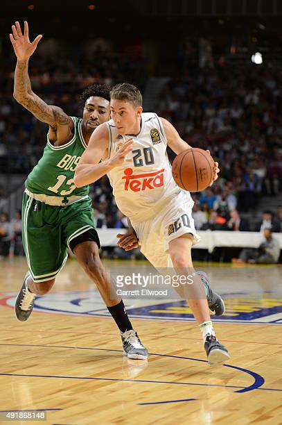 Jaycee Carroll of Real Madrid dribbles past James Young of the Boston Celtics as part of the 2015 Global Games on October 8 2015 at the Barclaycard...