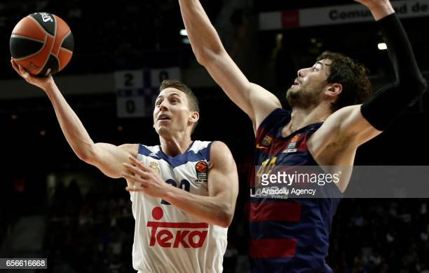 Jaycee Carroll of Real Madrid in action against Ante Tomic of Barcelona Lassa during the Turkish Airlines Euroleague basketball match between Real...