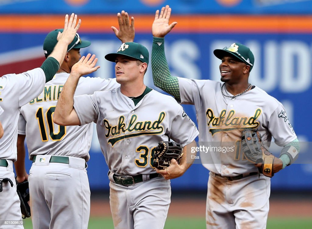 Jaycob Brugman #28 and Rajai Davis #11 of the Oakland Athletics celebrate the 3-2 win over the New York Mets on July 23, 2017 at Citi Field in the Flushing neighborhood of the Queens borough of New York City.