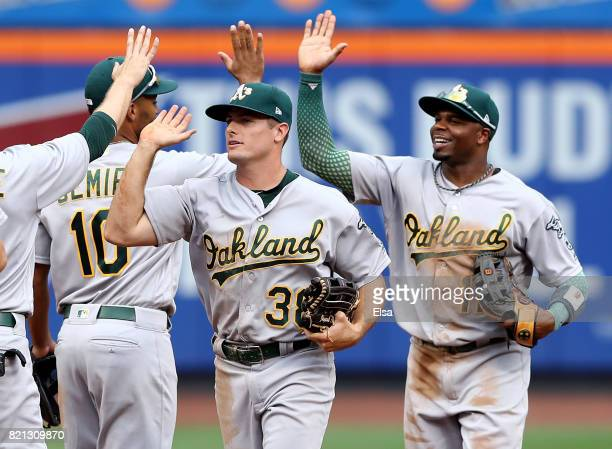 Jaycob Brugman and Rajai Davis of the Oakland Athletics celebrate the 32 win over the New York Mets on July 23 2017 at Citi Field in the Flushing...