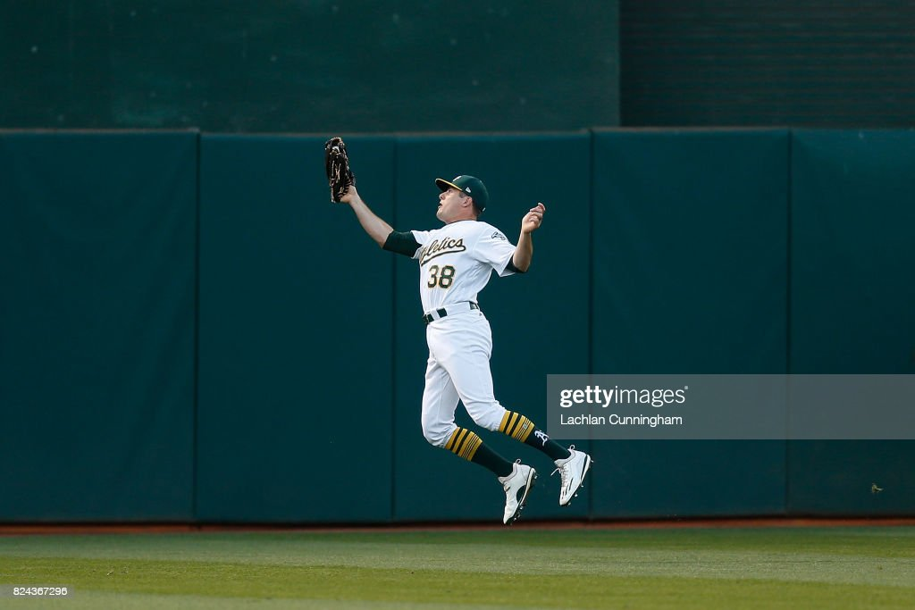 Jaycob Brugman #38 of the Oakland Athletics catches a fly ball hit by Robbie Grossman #36 of the Minnesota Twins in the fifth inning at Oakland Alameda Coliseum on July 29, 2017 in Oakland, California.