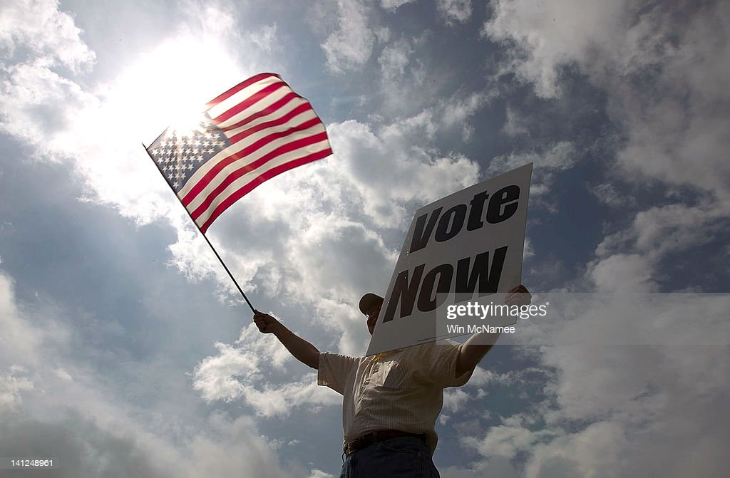 JayDanny Cooper urges Alabama residents to vote in the primary along the side of a highway March 13 2012 in Birmingham Alabama As the race for...