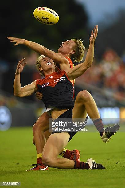 Jayden Hunt of the Demons and Darcy MacPherson of the Suns competes for the ball during the round seven AFL match between the Gold Coast Suns and the...