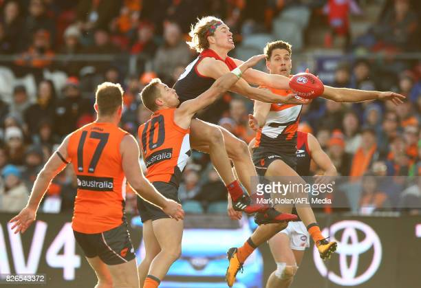 Jayden Hunt of the Demons and Josh Kelly of the Giants contest a mark during the round 20 AFL match between the Greater Western Sydney Giants and the...
