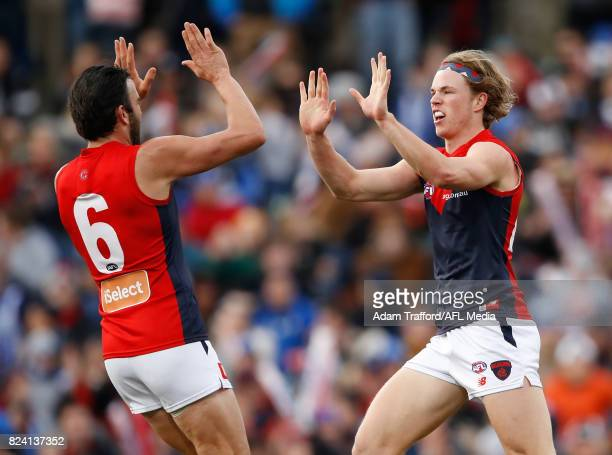 Jayden Hunt of the Demons celebrates a goal with Jordan Lewis of the Demons during the 2017 AFL round 19 match between the North Melbourne Kangaroos...