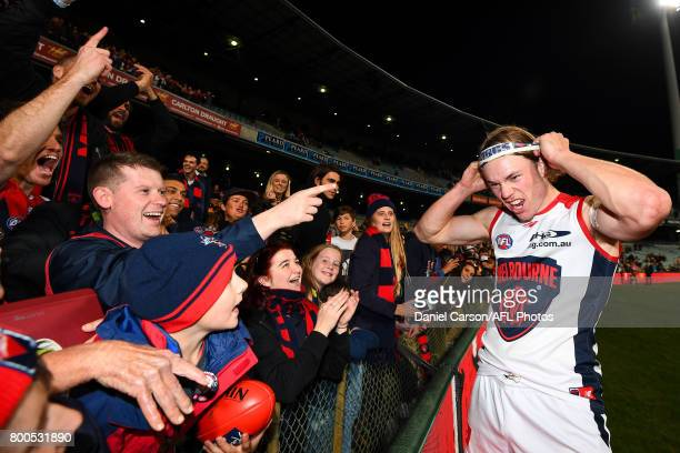 Jayden Hunt of the Demons celebrates with the fans and puts on a new headband during the 2017 AFL round 14 match between the West Coast Eagles and...