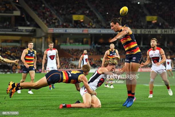 Jayden Hunt of the Demons competes for the ball with David Mackay and Troy Menzel of the Crows during the round eight AFL match between the Adelaide...