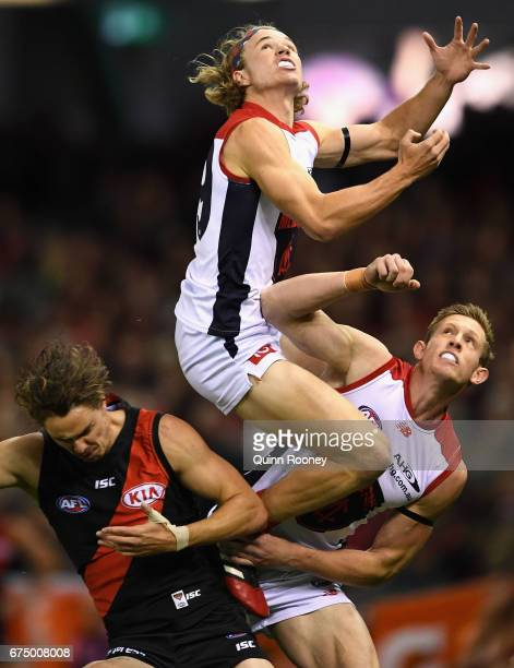 Jayden Hunt of the Demons flies for a mark during the round six AFL match between the Essendon Bombers and the Melbourne Demons at Etihad Stadium on...