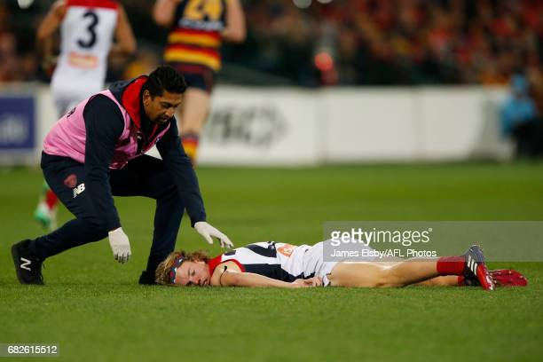 Jayden Hunt of the Demons is knocked out during the 2017 AFL round 08 match between the Adelaide Crows and the Melbourne Demons at the Adelaide Oval...