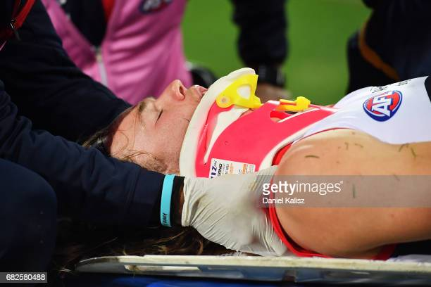 Jayden Hunt of the Demons is stretchered off the field after colliding with Sam Jacobs of the Crows during the round eight AFL match between the...