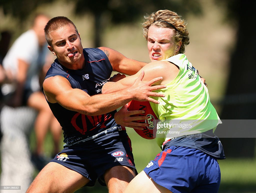 Jayden Hunt of the Demons is tackled by <a gi-track='captionPersonalityLinkClicked' href=/galleries/search?phrase=Ben+Kennedy+-+Australian+Rules+Football+Player&family=editorial&specificpeople=15138187 ng-click='$event.stopPropagation()'>Ben Kennedy</a> during a Melbourne Demons AFL pre-season training session at Gosch's Paddock on February 9, 2016 in Melbourne, Australia.