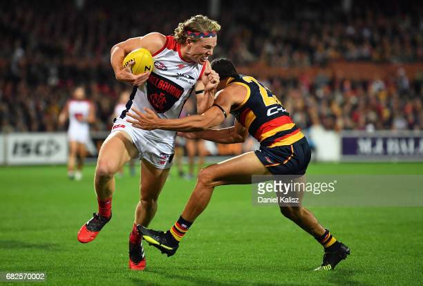 Jayden Hunt of the Demons is tackled by Charlie Cameron of the Crows during the round eight AFL match between the Adelaide Crows and the Melbourne...