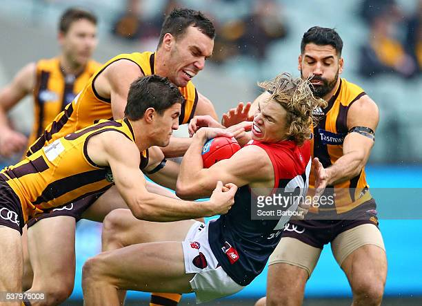 Jayden Hunt of the Demons is tackled by the Hawks defence during the round 11 AFL match between the Hawthorn Hawks and Melbourne Demons at Melbourne...