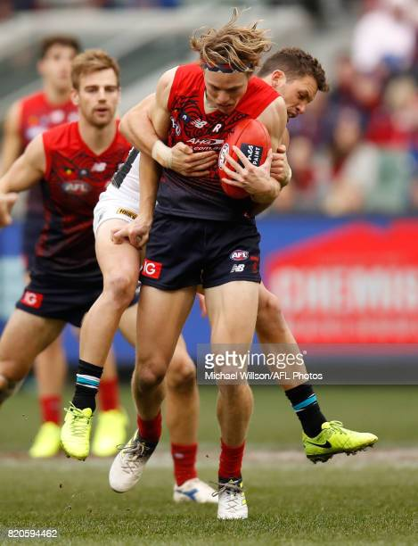 Jayden Hunt of the Demons is tackled by Travis Boak of the Power during the 2017 AFL round 18 match between the Melbourne Demons and the Port...