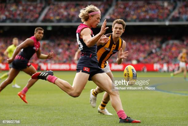 Jayden Hunt of the Demons kicks the ball during the 2017 AFL round 07 match between the Melbourne Demons and the Hawthorn Hawks at the Melbourne...
