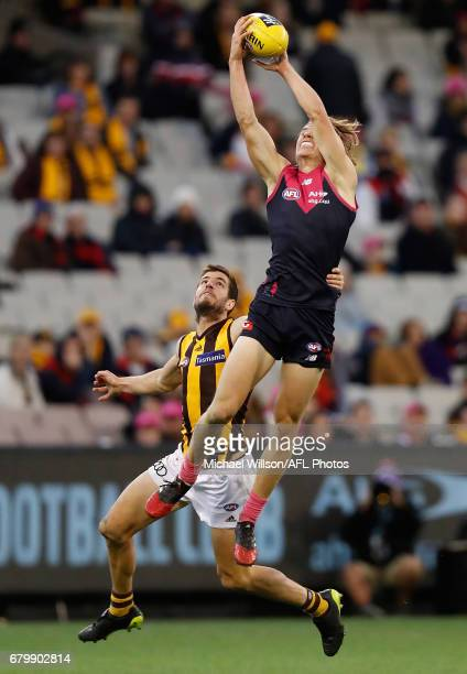 Jayden Hunt of the Demons marks over Ben Stratton of the Hawks during the 2017 AFL round 07 match between the Melbourne Demons and the Hawthorn Hawks...