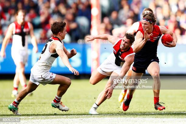 Jayden Hunt of the Demons runs with the ball during the round 21 AFL match between the Melbourne Demons and the St Kilda Saints at Melbourne Cricket...