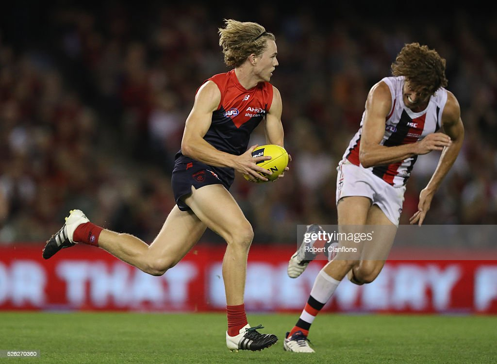 Jayden Hunt of the Demons runs with the ball during the round six AFL match between the Melbourne Demons and the St Kilda Saints at Etihad Stadium on April 30, 2016 in Melbourne, Australia.