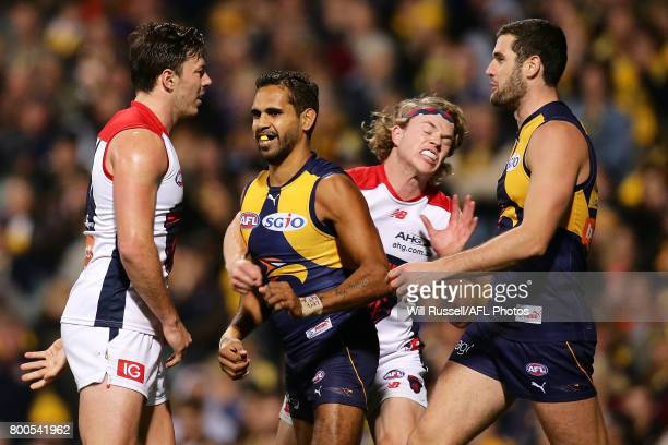 Jayden Hunt of the Demons strikes Lewis Jetta of the Eagles during the round 14 AFL match between the West Coast Eagles and the Melbourne Demons at...