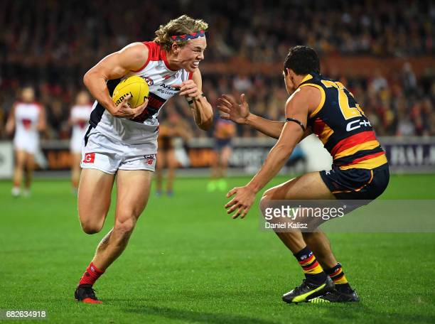 Jayden Hunt of the Demons tries to evade Charlie Cameron of the Crows during the round eight AFL match between the Adelaide Crows and the Melbourne...